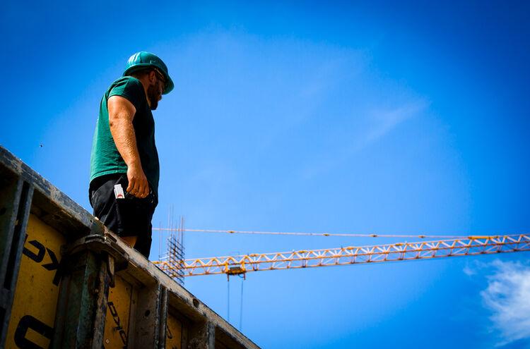 Bauarbeiter Kran Himmel